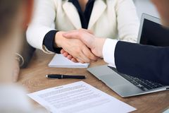 Close up of business people shaking hands at meeting or negotiation in the office. Partners are satisfied because. Signing contract stock images
