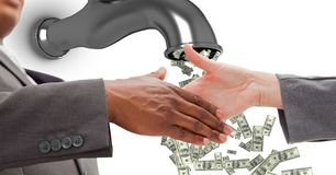 Close-up of business people shaking hands with money flowing from tap. Digital composite of Close-up of business people shaking hands with money flowing from tap Royalty Free Stock Image