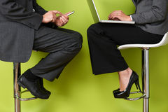 Close Up Of Business People Using Laptop And Mobile Phone Royalty Free Stock Photo