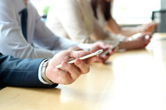 Close up of a business people  using mobile smart phones Royalty Free Stock Image