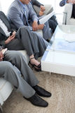 Close-up of business people in a waiting room Stock Image