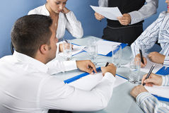 Close up of business people writing Stock Photography