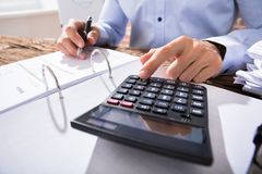 Businessperson Calculating Invoice Royalty Free Stock Images
