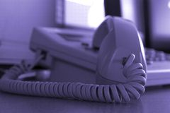 Close up Business Phone. Close up on a Business Phone with Focus on the Cord Royalty Free Stock Photos