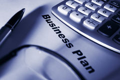 Close up of business plan. Differential focus blue tone stock images