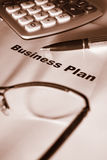 Close up of business plan. Differential focus sepia tone stock image