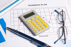Close up of business plan with graphs, charts and calculator Stock Photos