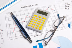Close up of business plan with graphs, charts, glasses, pen and Stock Photo