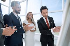 Close up. business team applauding in a business presentation. Business concept royalty free stock image