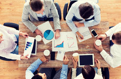 Close up of business team with coffee and papers Stock Images