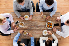 Close up of business team drinking coffee on lunch royalty free stock photos