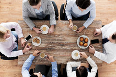 Close up of business team drinking coffee on lunch Royalty Free Stock Image