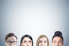 Close up of business team faces, gray stock image