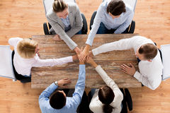 Close up of business team with hands on top Stock Image