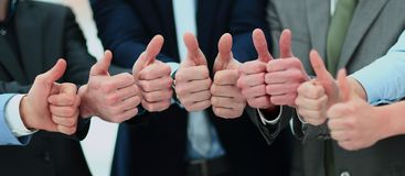 Cheering business people holding many thumbs thumbs up royalty free stock photo