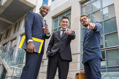 Close-up of business team holding their thumbs up Royalty Free Stock Image