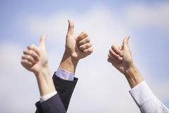 Close-up of business team holding their thumbs up. Royalty Free Stock Photos