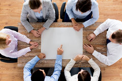 Close up of business team with paper at table Royalty Free Stock Photos