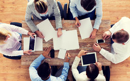 Close up of business team with papers and gadgets Royalty Free Stock Images