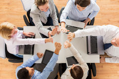 Close up of business team showing high five Stock Image