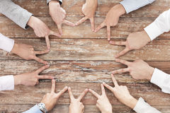 Close up of business team showing victory gesture Stock Photo
