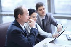 Close up.business team sitting at Desk. photo with copy space royalty free stock image
