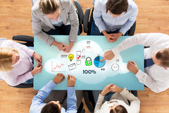 Close up of business team sitting at table Royalty Free Stock Images