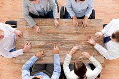 Close up of business team sitting at table Royalty Free Stock Photo