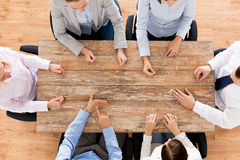 Close up of business team sitting at table Stock Photos