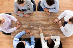 Close up of business team sitting at table Royalty Free Stock Photography