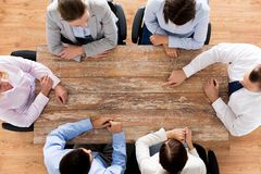 Close up of business team sitting at table Stock Image