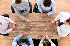 Close up of business team sitting at table Stock Images