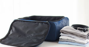 Close up of business travel bag and clothes Royalty Free Stock Image