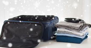 Close up of business travel bag and clothes Royalty Free Stock Photo
