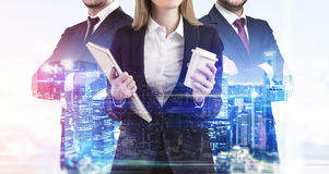 Close up of business trio and a night cityscape stock images