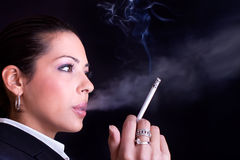 Close up business woman with cigarette Stock Photos