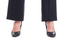 Close-up of business woman feet wearing black shoes standing spr Stock Photos