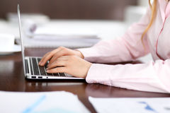Close up of business woman hands typing on laptop computer Royalty Free Stock Images