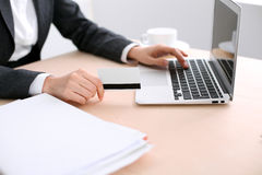 Close up of business woman hands using credit card and laptop computer Royalty Free Stock Photo