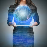 Close up of business woman holding digital globe Stock Photography
