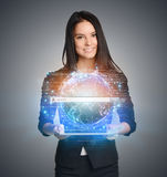 Close up of business woman holding digital globe Royalty Free Stock Images