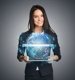 Close up of business woman holding digital globe Stock Photos