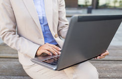 Close up of business woman with laptop in city Stock Images