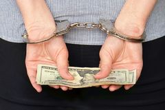 Criminal hands locked in handcuffs. Close-up view royalty free stock photo