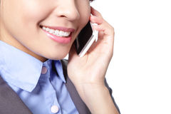 Close up of business woman speaks phone Stock Photo