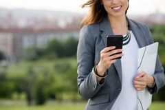 Close up of business woman texting on cellphone Stock Photo