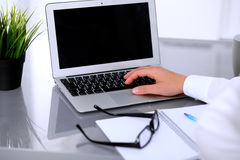 Close-up of Business woman is typing on laptop computer.  Stock Images