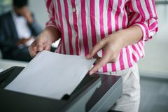 Close up of business woman uses copier. Businesswoman using pho stock images