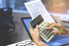 Close up of businessman or accountant hands holding calculator stock photos