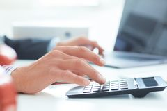 Close up of businessman or accountant hand working on calculator. Calculate business data, accountancy document and. Close up of businessman or accountant royalty free stock images